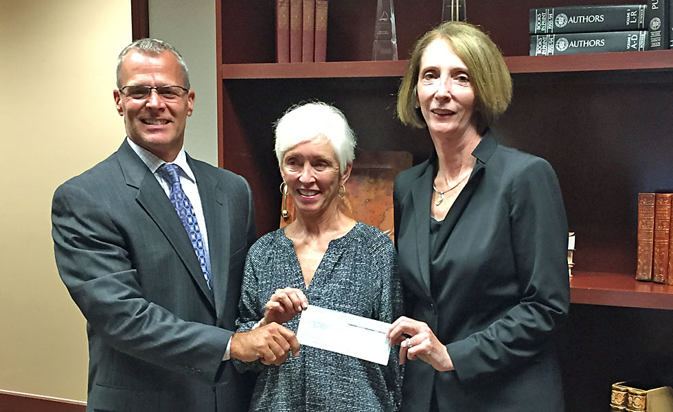 The Huntington National Bank donates $5K to Angels Undercover's Clothe A School Program